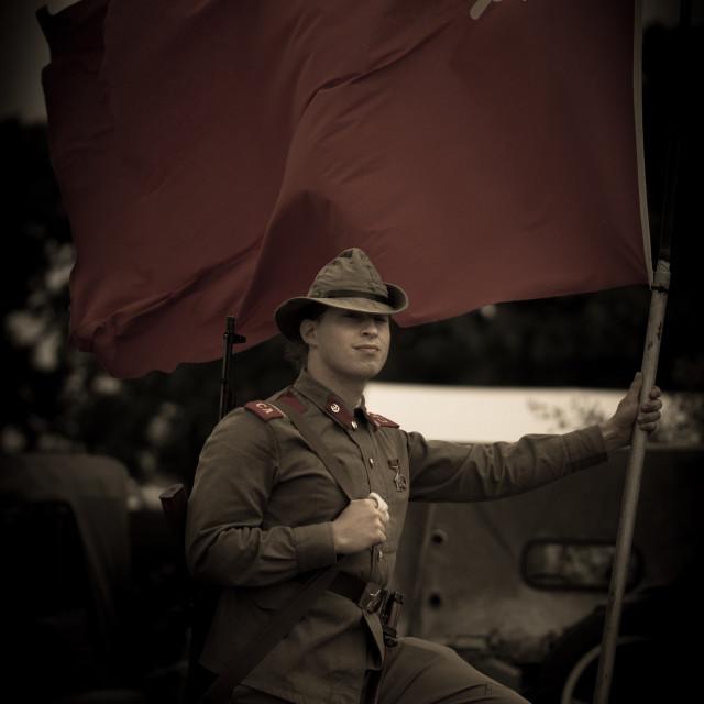 """Soviet Soldier holding flag"" stock image"