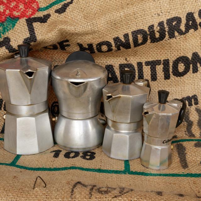 """Four italian moka on coffee jute bag"" stock image"