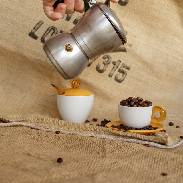 """""""Hand of man pour coffee beans into cup"""" stock image"""