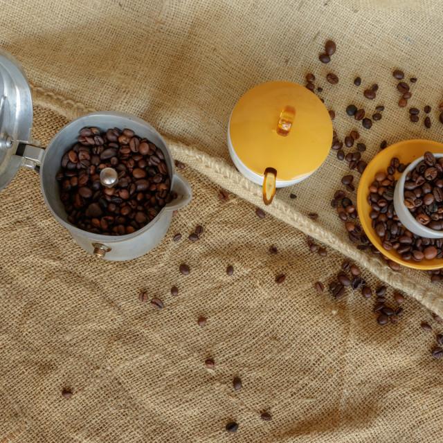"""""""High angle over moka and coffee beans into cup"""" stock image"""