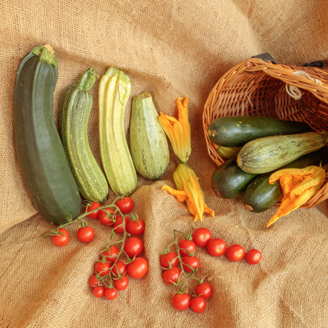 """""""Harvest of zucchini and cherry tomatoes on jute"""" stock image"""