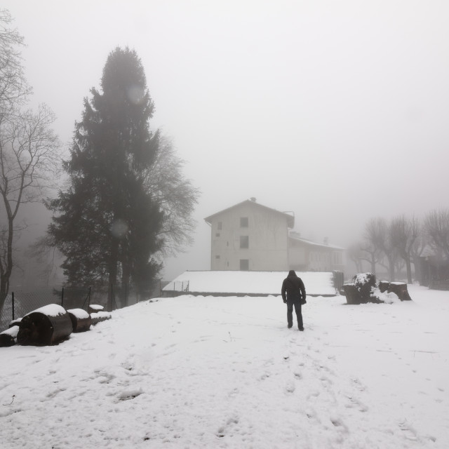 """Lonely man walking in the fog, in the winter, with snowy landscape"" stock image"