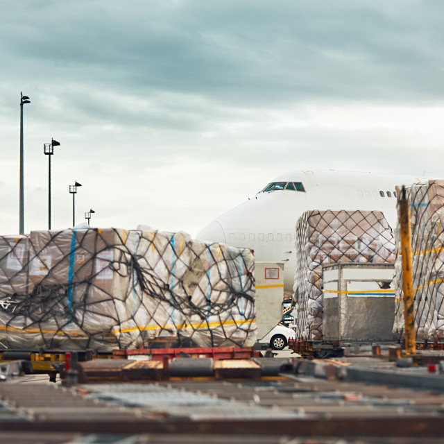 """Loading of the cargo airplane"" stock image"