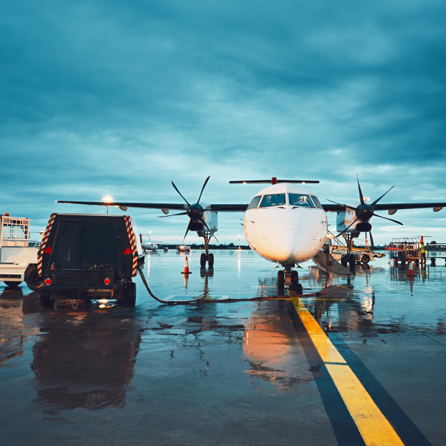 """A busy airport in the rain"" stock image"