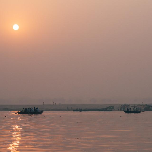 """""""Sunrise along the Ganges, Varanasi."""" stock image"""