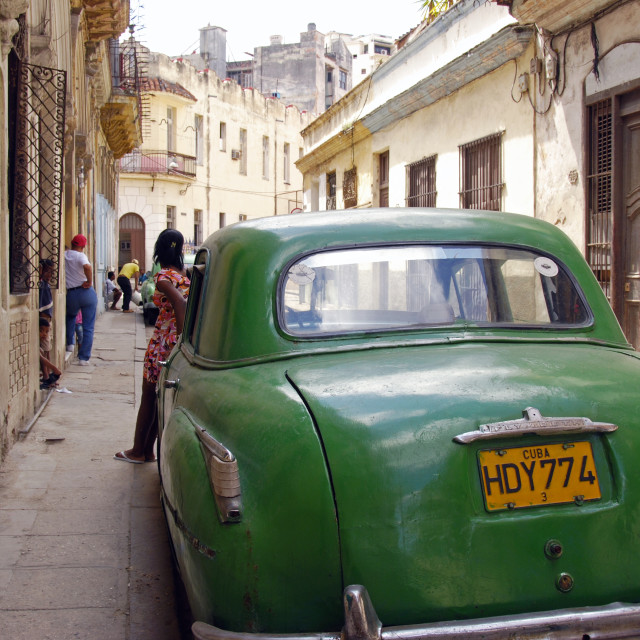 """Girl & green car; Havana, Cuba"" stock image"