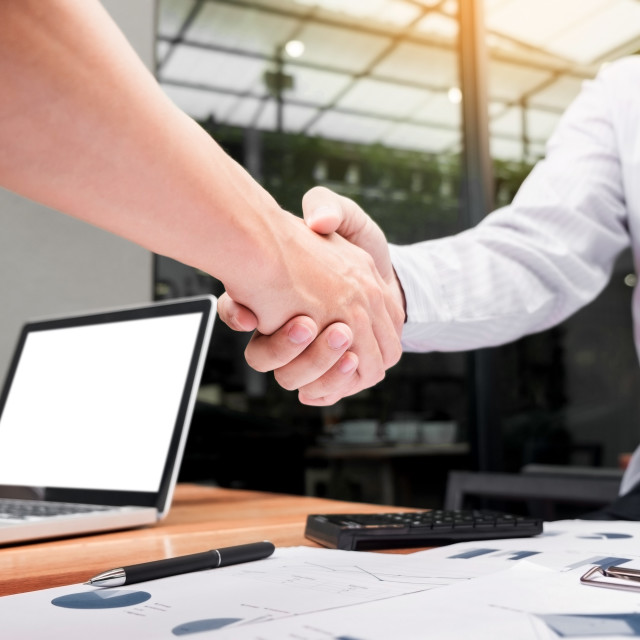 """Two confident business man shaking hands during a meeting at out"" stock image"