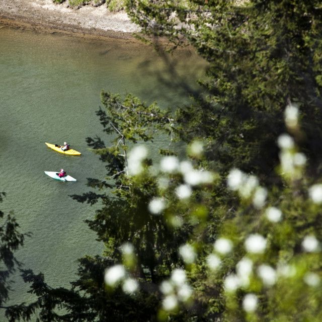 """An adventurous retired couple kayak down a large river in Idaho."" stock image"
