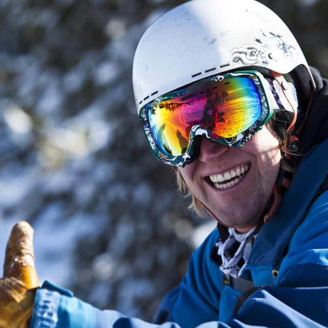 """""""A athletic man smiling in the backcountry in Montana."""" stock image"""