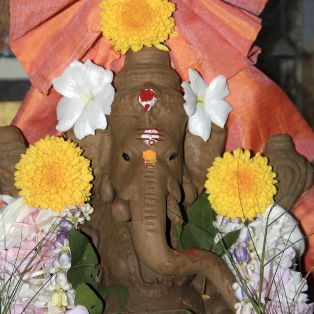 """""""Flower Studded Ganesha Idol"""" stock image"""