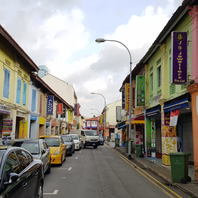 """A main road in Little India flanked by authentic two storied shop houses"" stock image"