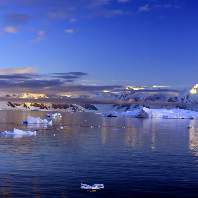 """Icebergs floating in the Lemaire Channel at Sunset"" stock image"