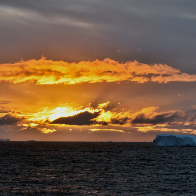 """Sunset in Antarctica with iceberg"" stock image"