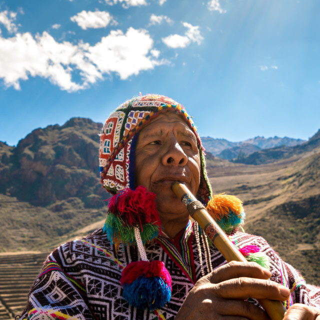 """Peruvian man playing a flute, Sacred Valley, Cusco, Peru"" stock image"