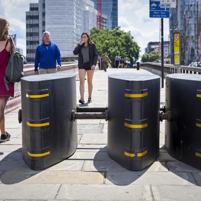 """Security barriers set up on Blackfriars bridge walkway, London"" stock image"