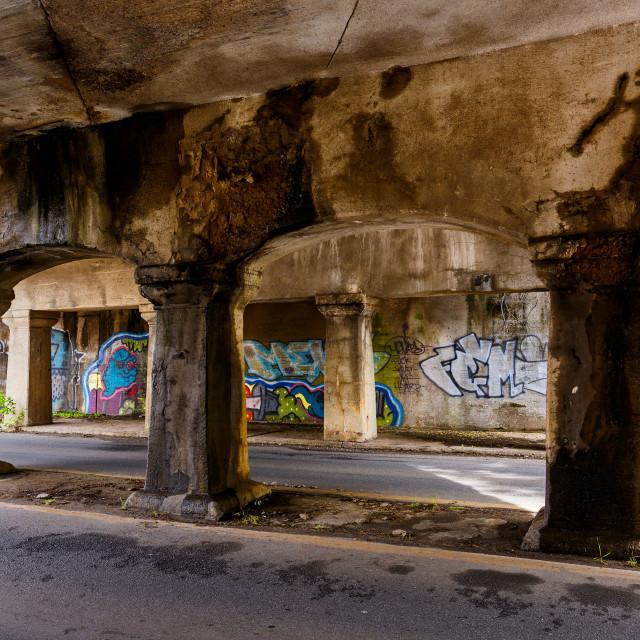 """Graffiti on a wall underneath a bridge in Little Rock Arkansas"" stock image"
