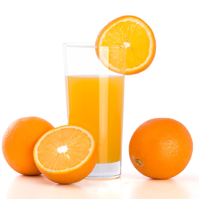 """Orange and glass of juice on white background"" stock image"