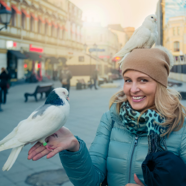 """""""Pretty blond woman with bird"""" stock image"""