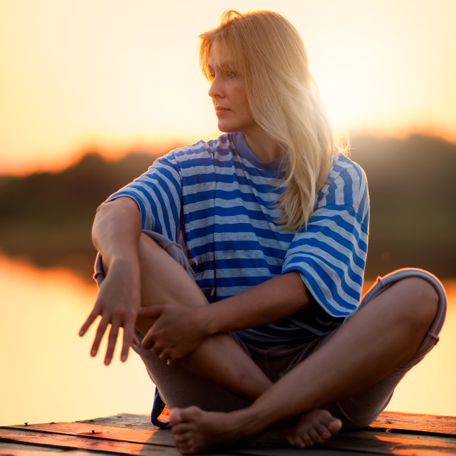"""""""Pretty blond woman in sunset time by summer"""" stock image"""