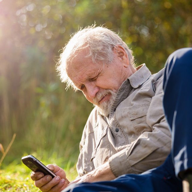 """""""Portrait of senior outdoor with mobile"""" stock image"""