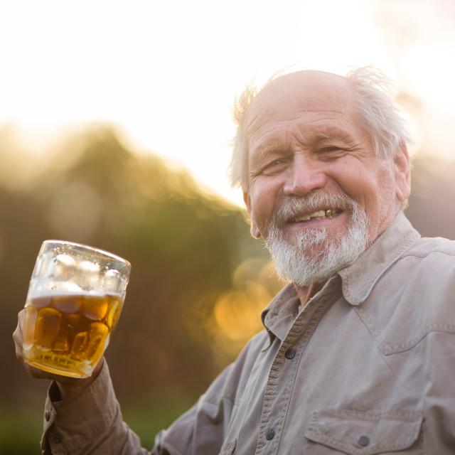 """""""Senior drinks beer outdoor"""" stock image"""