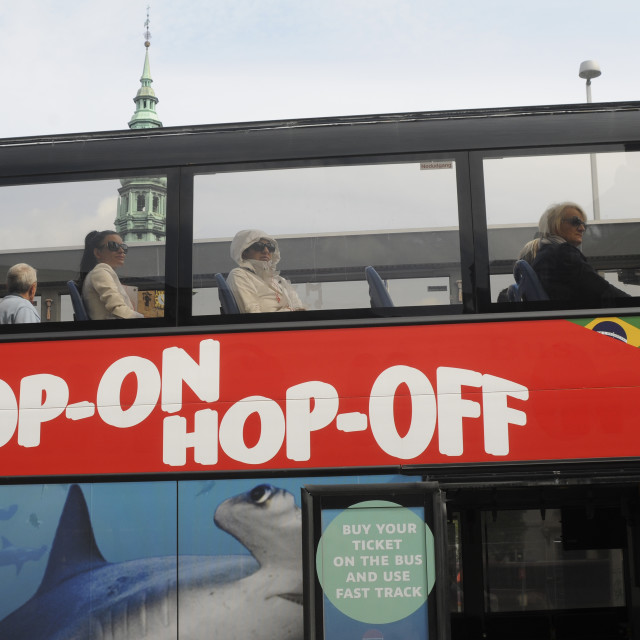 """""""TOURISTS RIDE SIGHT SEEING HOP-ON-HOP-OFF BUS"""" stock image"""