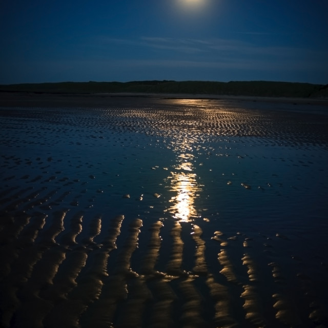 """""""Full moon over Embleton Beach."""" stock image"""