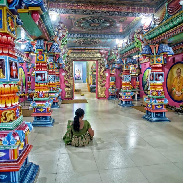 """Quiet meditation in the Kali Kovil temple, Trincomalee, Sri Lanka"" stock image"