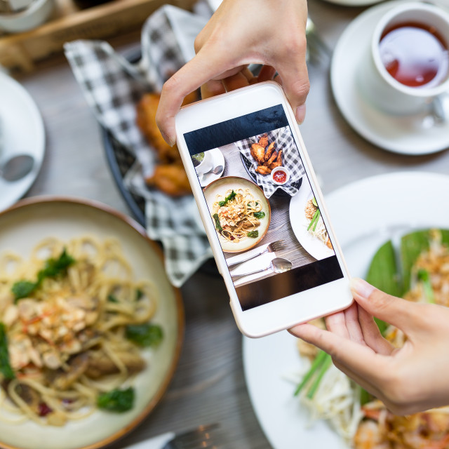 """""""Cellphone taking photo on food from top view"""" stock image"""