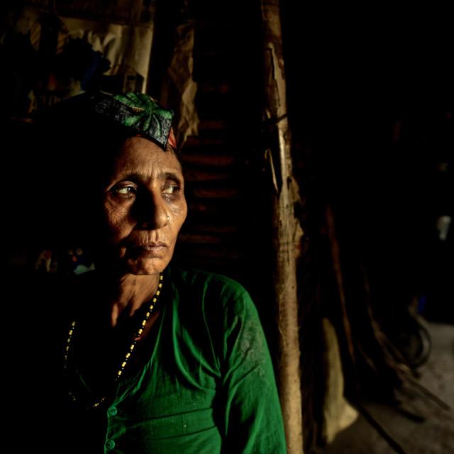 """- Beldangi II, Damak, Nepal, 2014: Damar Kumari Adhikari, a widow of age 53..."" stock image"