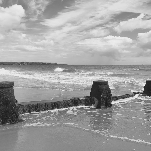 """Exmouth over the sea defences at Dawlish Warren"" stock image"