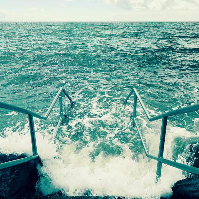 """Steps into the sea at Dawlish Warren, Devon"" stock image"