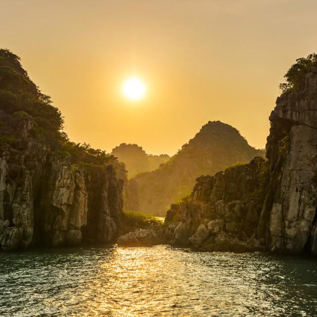 """Romantic Halong bay sunset over limestone rocks, Vietnam"" stock image"