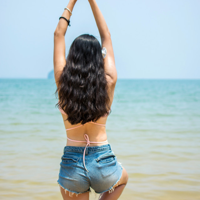 """""""Girl in yoga tree pose on the beach"""" stock image"""