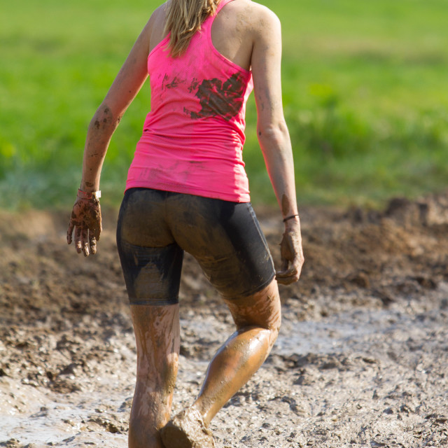 """Girl during a mud race"" stock image"