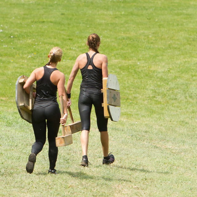 """Girls during a mud race"" stock image"