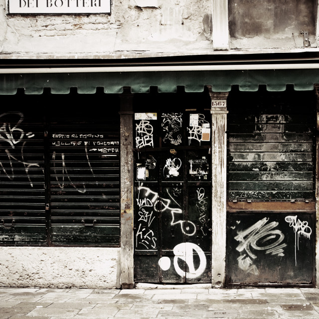 """Closed shop in Venice with graffiti"" stock image"