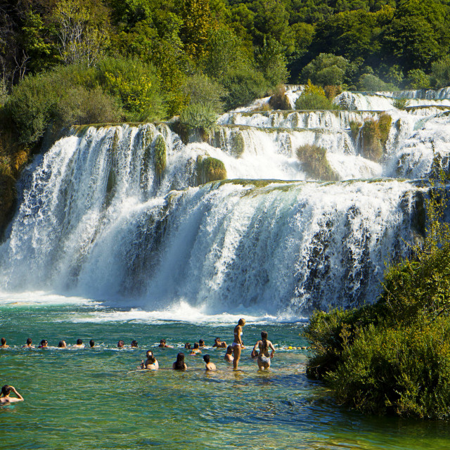"""Tourists at Krka waterfalls of Krka National park, Croatia"" stock image"