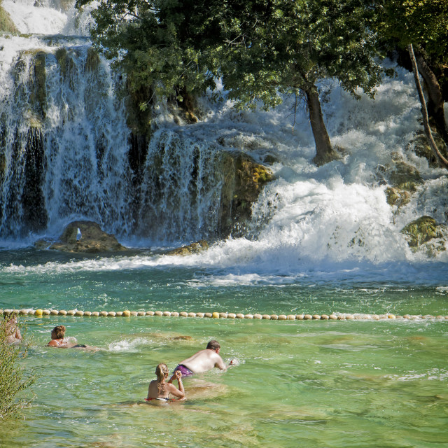 """Tourists swim at Krka waterfalls, Croatia"" stock image"