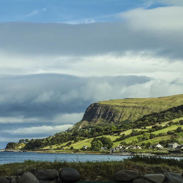 """A sunny moment on Antrim Coast"" stock image"