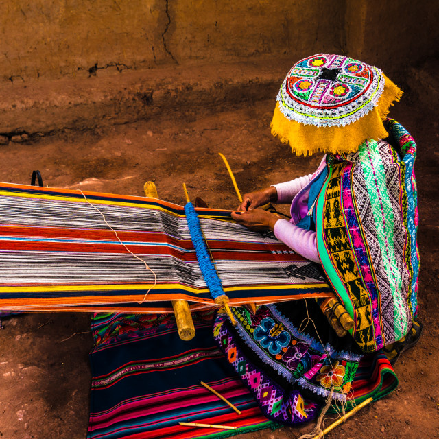 """Peruvian woman weaving colorful alpaca wool, using ancient techniques"" stock image"