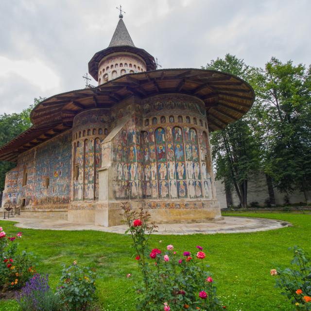 """Voronet Monastery painted church in Moldavia"" stock image"
