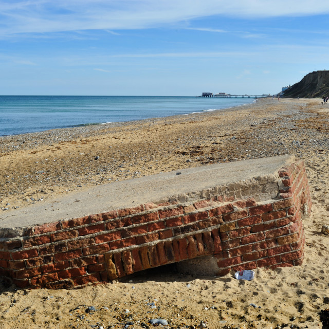 """A WW2 Pillbox lies on the beach near Cromer, Norfolk"" stock image"