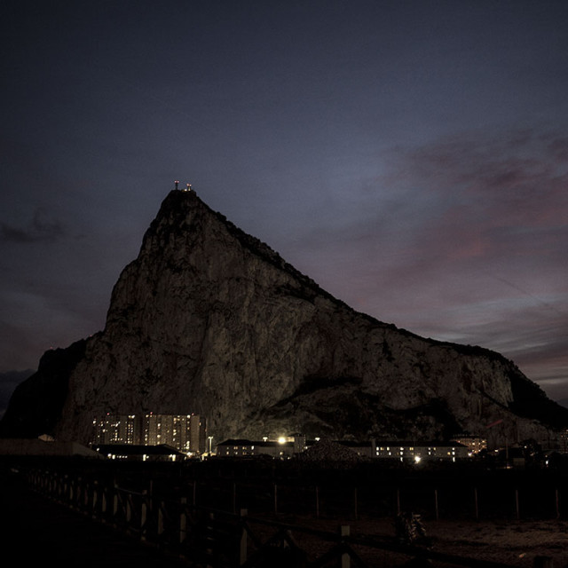 """A view of The Rock of Gibraltar from neibourgh spanish city of La Linea as sun sets; La Linea, Spain; 10012017; © Javier Fergo"" stock image"