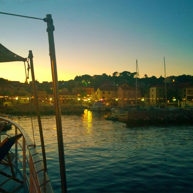"""Sali, Croatia -Night landscape view of Sali waterfront from cruise ship deck..."" stock image"