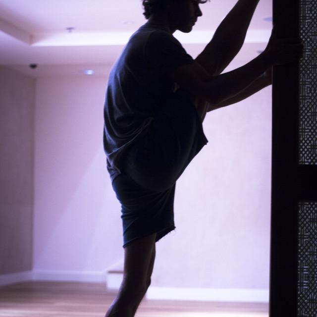 """Man yoga stretching splits"" stock image"