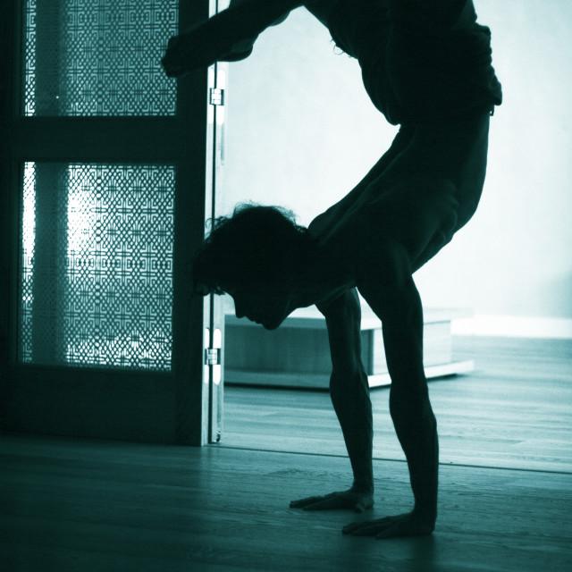 """Man yoga handstand"" stock image"