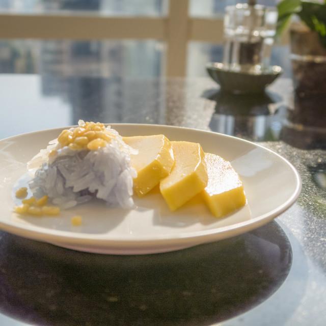 """Mango sticky rice, Thai Dessert, on a white plate"" stock image"
