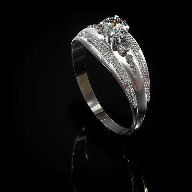 """Silver engagement band with diamond gem."" stock image"