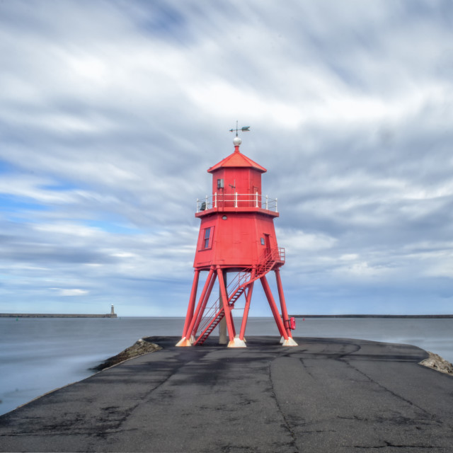 """Clouds over the Groyne"" stock image"